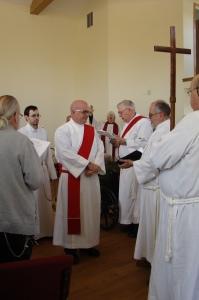 The Gospel is read by board member Deacon Keith Libolt.